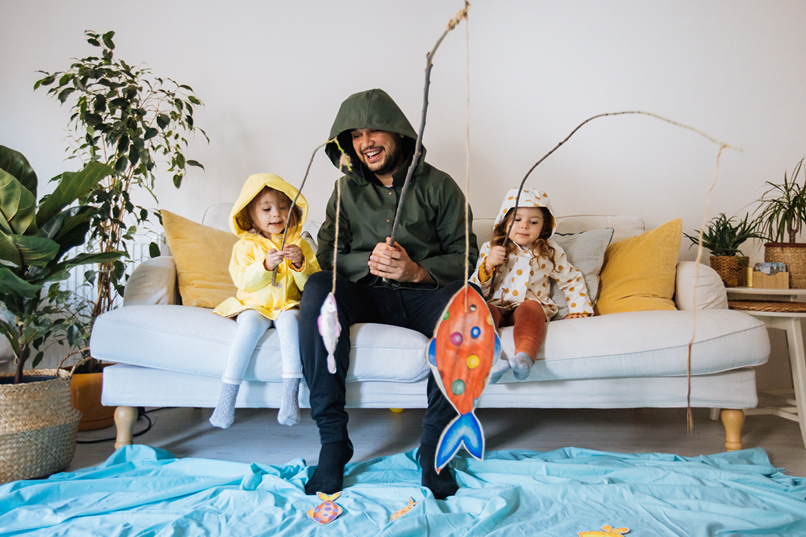 A family plays inside safely as a hurricane approaches their area